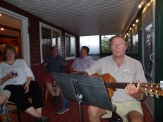 Rodney playing guitar for his guests